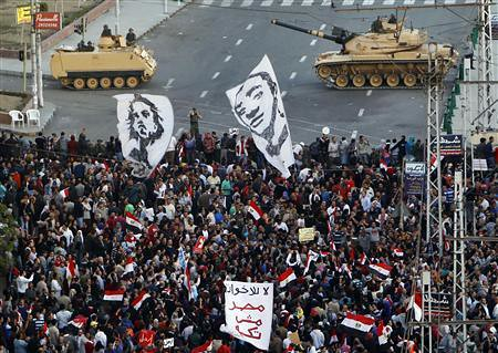 Egyptians demonstrate in Cairo outside the presidential palace. The demonstration demanded that President Morsi cancel the December 15 constitutional referendum. by Pan-African News Wire File Photos