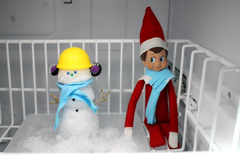 Snowman in the Freezer Elf on the Shelf. Click for more ideas! #elfontheshelf