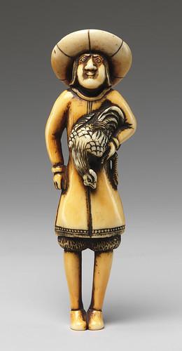 022- Netsuke -Extranjero que lleva un gallo -siglo 19-en marfil- Metropolitan Museum of Art