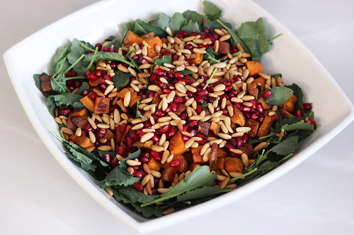 Baby Kale and Roasted Sweet Potato Salad with Pomegranate and Toasted Pine Nuts