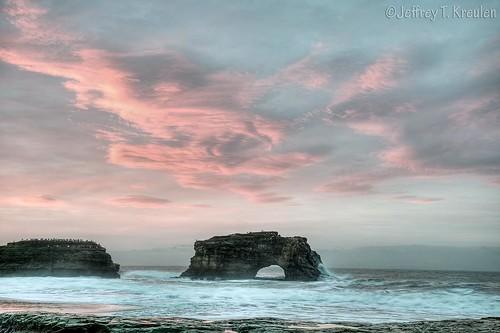 ocean california morning pink sky cloud santacruz bird beach rock sunrise coast wave pacificocean naturalbridgesstatebeach