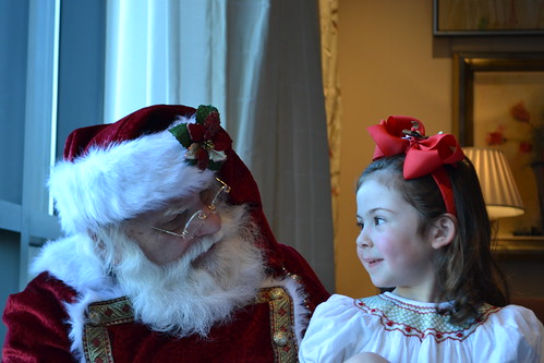 East Cobber Harper Wentz whispering her list to Santa.