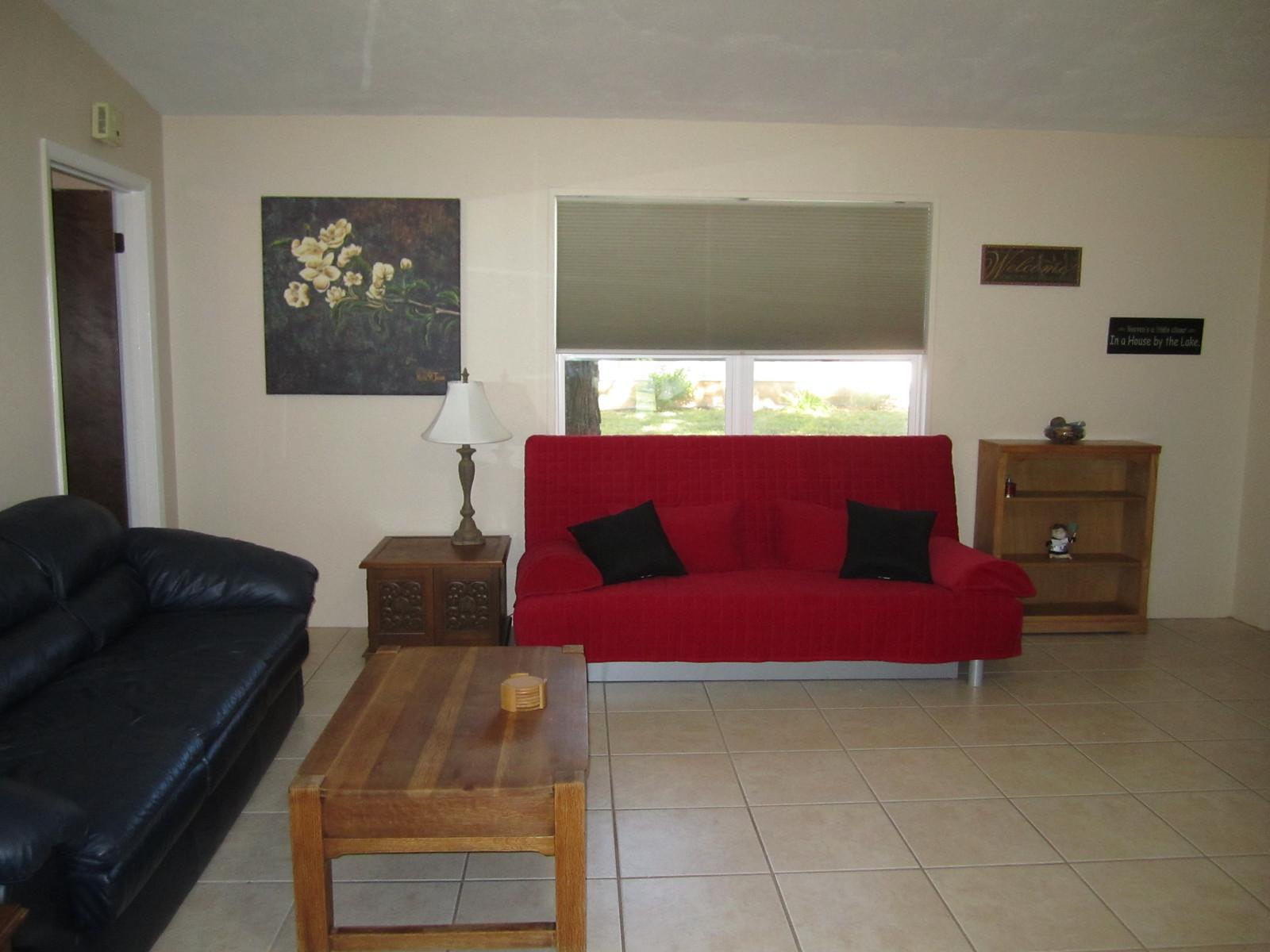 Living room queen size futons interior design company for Futon decorating living room