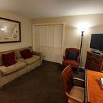 Living room view to closed bedroom doors