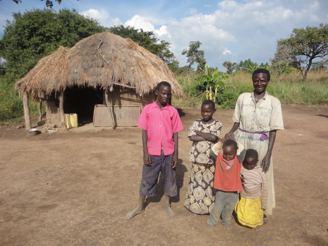 Lucy and her grandchildren outside their home in Ogongora