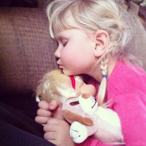 Snuggled with her new doll and puppy. Early morning has caught up with her. #hannahbaby #couldeatherup #snugglewhileyoucan #lovemygirl