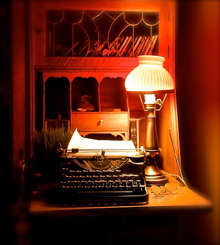 Lamp, typewriter, and specs..