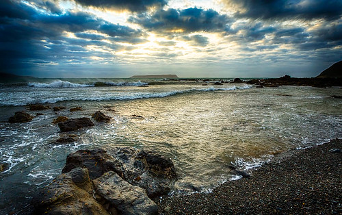 sea newzealand storm beach clouds landscape rocks waves windy plimmerton watersunset stewartbaird