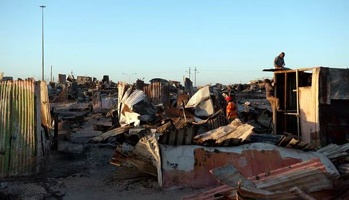 Khayelitsha fire displaced thousands near Cape Town, South Africa. Three people were reported killed when 800 informal homes were destroyed. by Pan-African News Wire File Photos