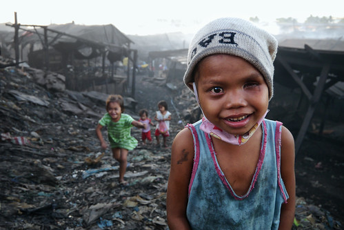 Charcoal Factory, Tondo - A partial blind charcoal girl