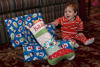 Happy boy with his stocking on Christmas day