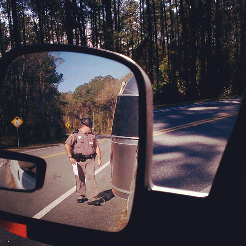 I think he pulled us over just to peek at the airstream. #speedtrap #florida #noticket #justawarning #airstream