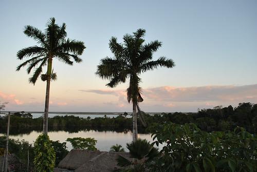 sunset lake azul mexico yucatan palm cenote peninsula roo quintana treets bacalar