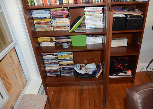 the new bookshelves- DVDs and Wii games