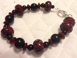 Red Lampwork beads with horn & Onyx