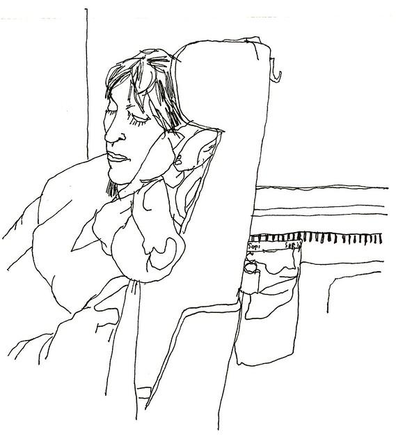 sover på tåg