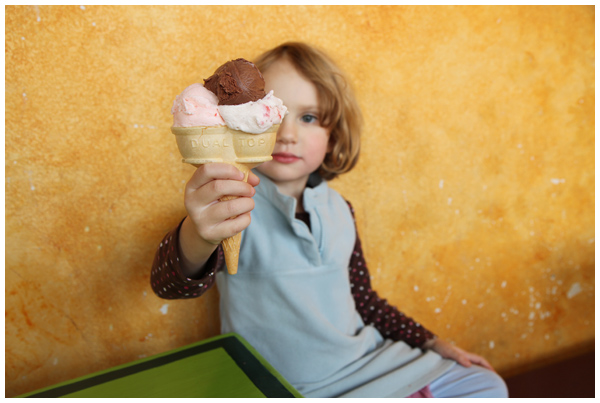 A little girl and her giant ice cream cone