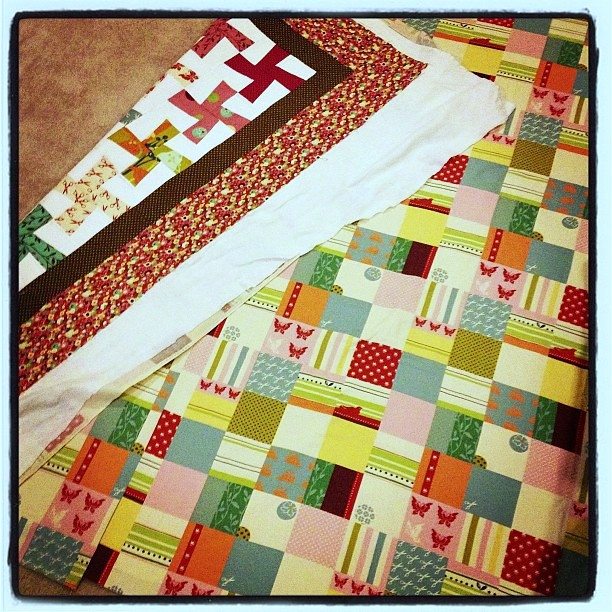 Quilt 3 of 5 basted! #wonderland
