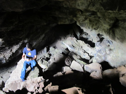 Exploring a lava Tube near Kamilo Beach, Hawaii