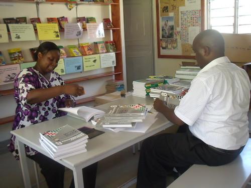 Mr Pius & Madam Sharon distribute the books.JPG