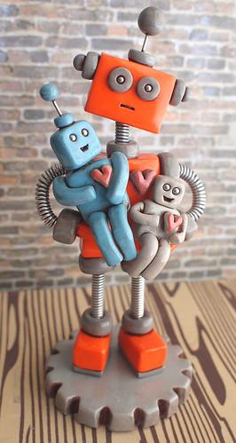 Commission: Robot Dad holding children robots by HerArtSheLoves