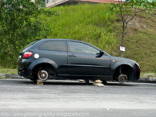 only in malaysia, all four wheels stolen, somewhere in seri kembangan 282384_10150258091463276_2176175_n