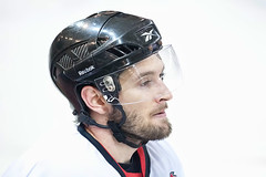 helmet, protective gear in sports, hockey protective equipment, personal protective equipment, clothing, player, athlete, headgear,