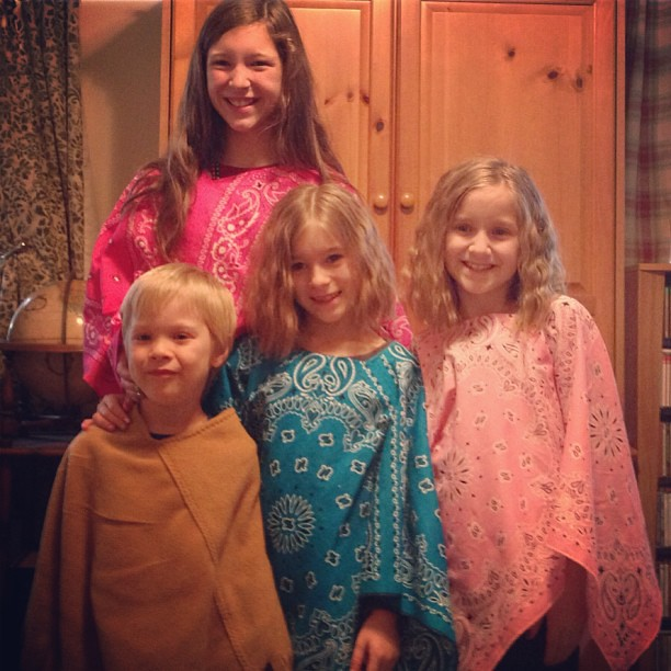 Four of my five at my mom & day's today... wearing the ponchos my mom made for them!