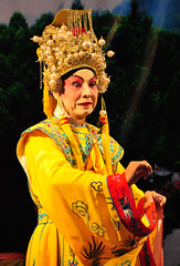 carnival(0.0), temple(1.0), yellow(1.0), tradition(1.0), performing arts(1.0), musical theatre(1.0), peking opera(1.0), entertainment(1.0), dance(1.0),