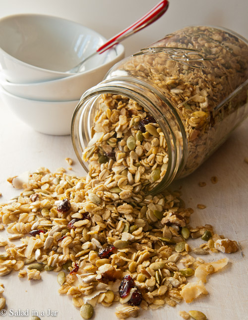 My Favorite Homemade Granola - Homemade granola falling out of a jar
