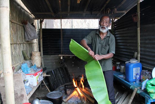 Grandpa breaking the banana leaf