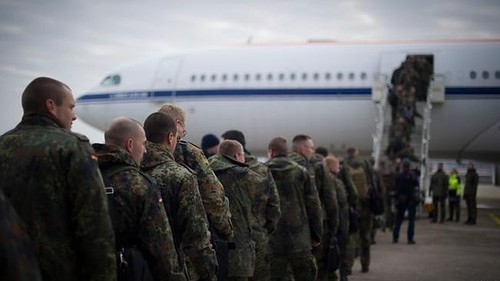 German troops boarding plane. Troops from the European nation are being deployed to Turkey along with patroit missiles being placed on the border with Syria. by Pan-African News Wire File Photos