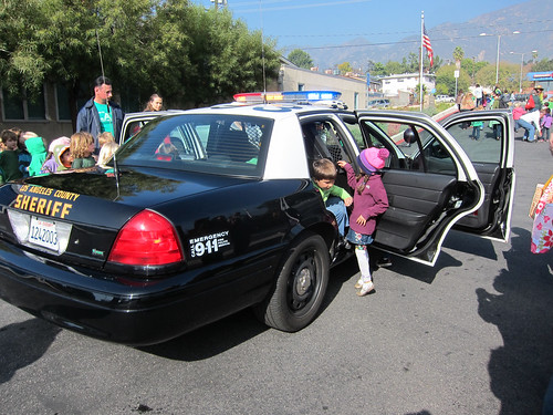 Climbing out of the sheriff's car