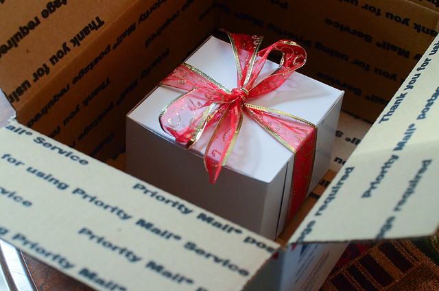 A gift box with cookies being boxed up for shipping.