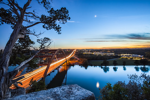 park travel bridge blue sunset orange usa sun moon tree texture canon austin reflections river flow high texas arch traffic unitedstates infinity tx branches trails lighttrails bluehour hillcountry distance viewpoint 1740 austintx pennybackerbridge pennybacker canon5dmkii canon5dmk2
