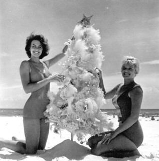 Meriam De Shazo and Kenna Morris modeling with a Christmas Tree on Pensacola Beach