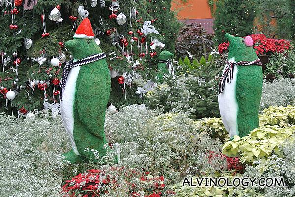 Three green penguins