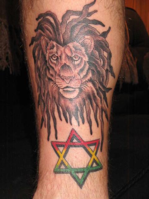 Lion_and_Star_Leg_Tattoo_Designs