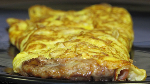 Three Pig omelet (ham, bacon, sausage, and cheese) by Coyoty
