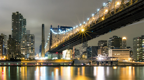 city nyc newyorkcity longexposure bridge light sky ny newyork reflection night skyscraper buildings river print island photography lights photo scenery gallery cityscape unitedstates image cloudy manhattan fineart stock scenic picture canvas eastriver flare suspensionbridge queensborobridge rooseveltisland 59stbridge croporama mikeorso deffractionspikes