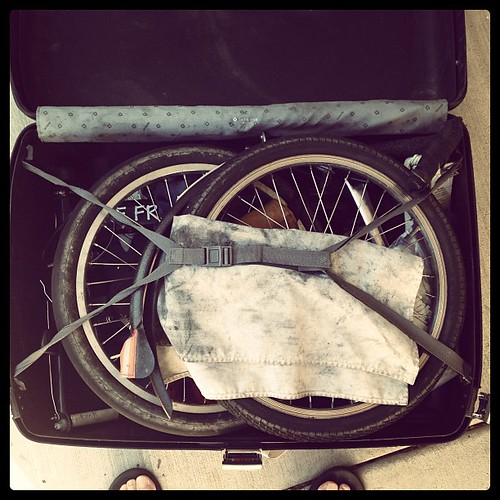 A dirty bike in a suitcase