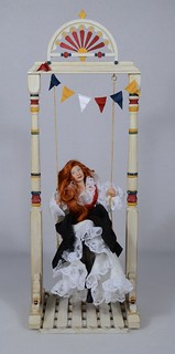 Porcelain Lady Doll on County Fair Swing