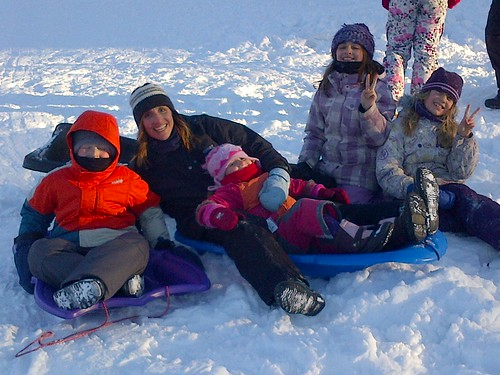 Cousins sledding by ngoldapple