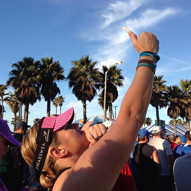 Great photo of me by @caseyruns when I was trying to post a photo on @Instagram at the @lovesurfcity 1/2 Marathon yesterday. I couldn't get any cell service. #surfcity #teamsparkle