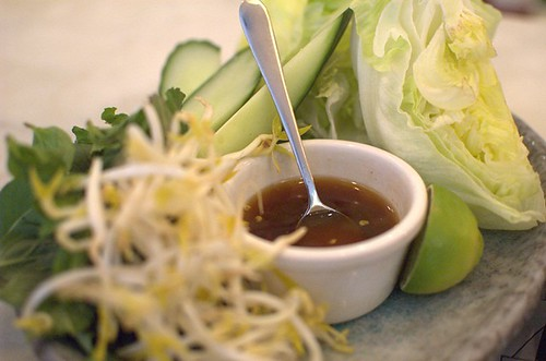 Plate of iceberg lettuce hearts with cucumber, beansprouts, herbs & Nuoc Cham