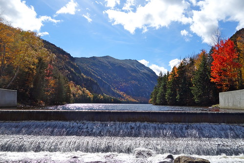 autumn trees sky lake color fall water leaves clouds dam essexcounty foliage upstatenewyork newyorkstate amr indianhead adirondackmountains ausableclub lowerausablelake mountcolvin adirondackmountainreserve lakeroadtrail sthubertsnewyork