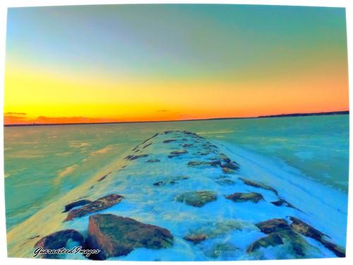 winter sunset seascape cold ice landscape rocks boulders