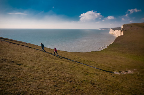 travel sea england people seascape water photography coast couple view action south shoreline hike cliffs trail coastal coastline sevensisters steep