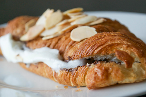 croissant with whipped cream toasted almonds and dark chocolate