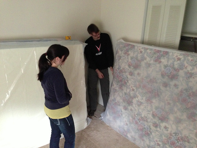 Sheryl and Aaron Contemplating Mattresses